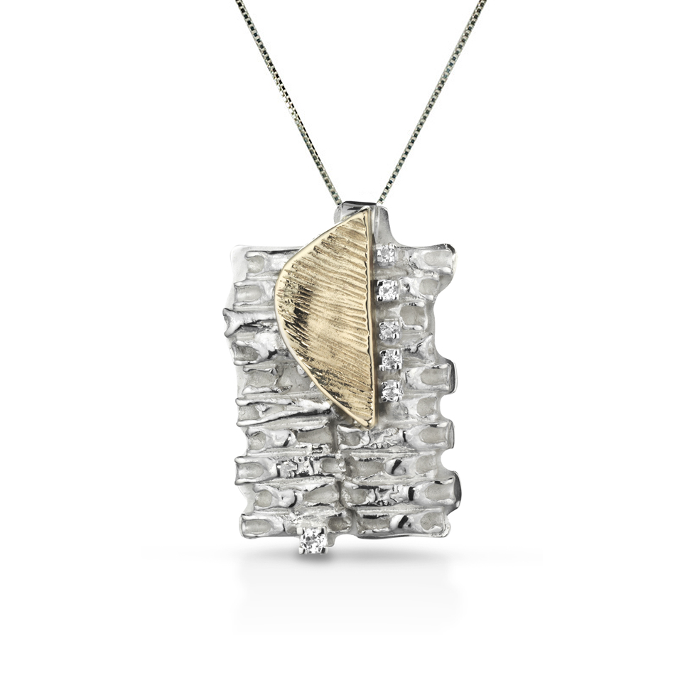 Silver and bronze necklace pendant with white topazes