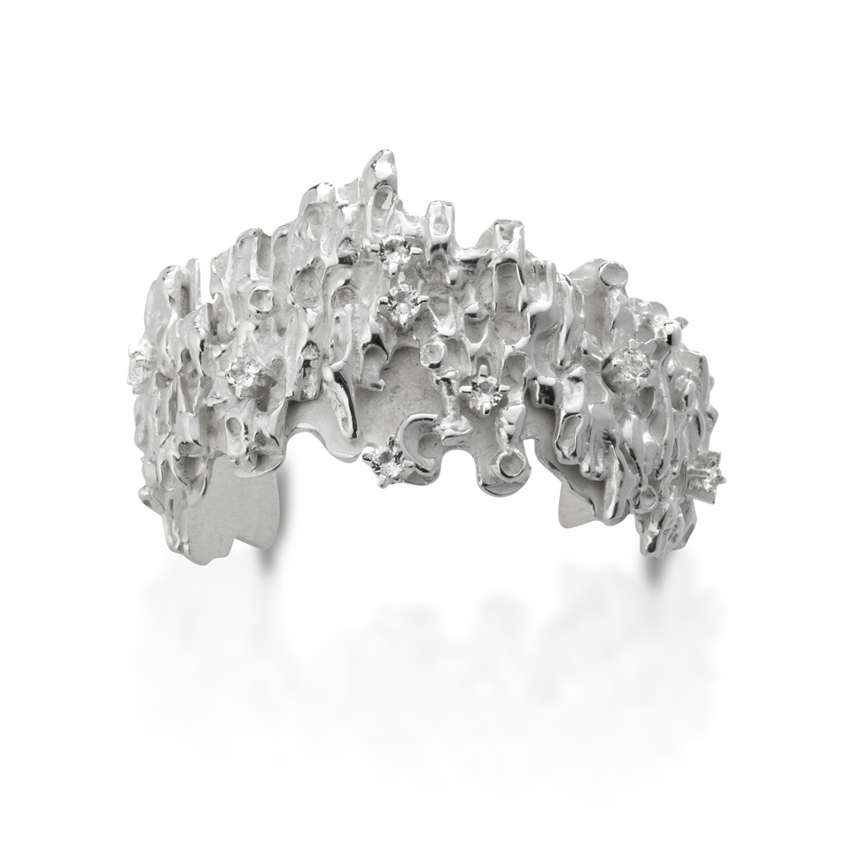 Silver bracelet with white topazes